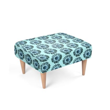 Pretty blue daisy blossom on turquoise background Footstool