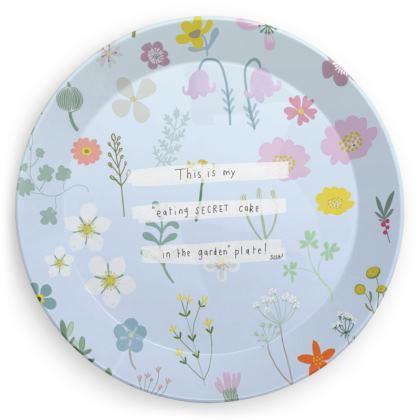 Eating 'secret cake in the garden' plate
