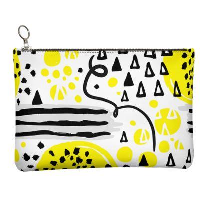 black yellow geometrical leather clutch bag