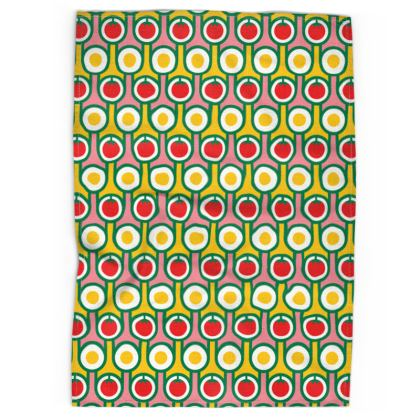 Yellow fried eggs red tomatoes tea towel