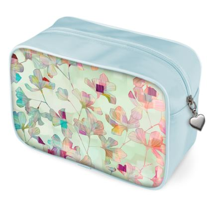 Multi-functional toiletry bag with a botanical pattern in a colorful design