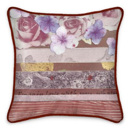 A sumptious Silk Cushion.  Pink, blue/mauve and gold floral Silk Cushion with touches of gold and fragments of romantic text.