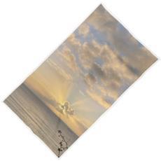 Sunrays over the bay beach towel