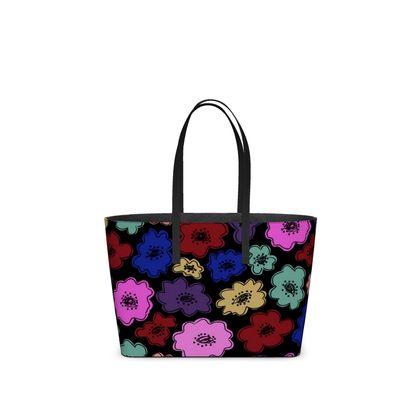 Kika Tote in bright bold floral pattern on black