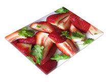 Glasschneidebrett mit Foto von Erdbeeren