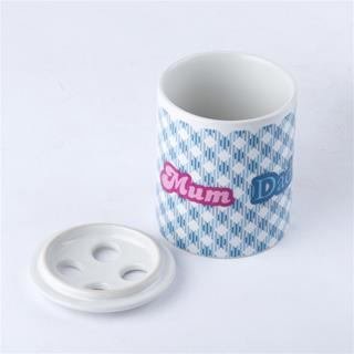 Ceramic toothbrush holder with lid