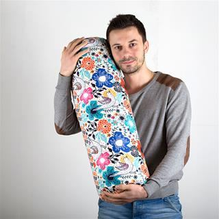 customised large bolster cushions being held by person to demonstrate the size