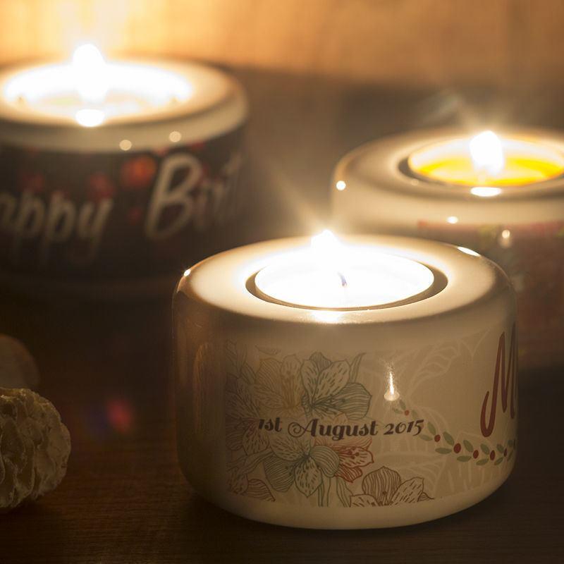 portavelas con velas de t