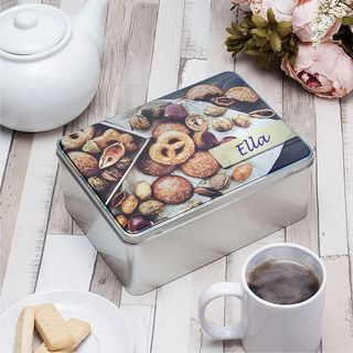 custom biscuit tin on a table setting with tea and biscuits