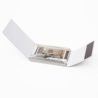 Business card holder with magnetic closure.