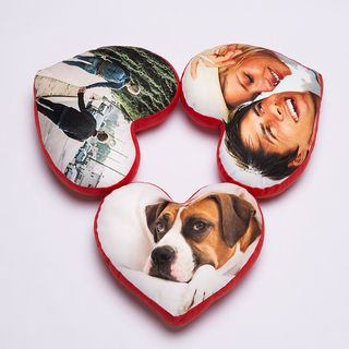 trio of personalised heart cushions printed with unique photos
