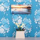 personalised photo clock printed with sunset landscape picture against blue wallpaper
