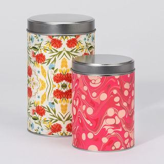 Large and small printed tins