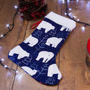 customized Christmas stockings with polar bear design surrounded by fairy lights and festive accessories